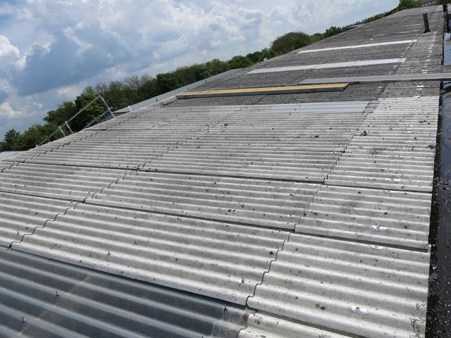 Asbestos Roof Coating Using Asbestoseal 20